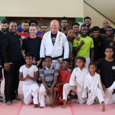 Brazilian Jiu Jitsu Black Belt Dave Mark (Center) visiting from Canada, to his right wrestling coach Darek Wasowicz of Poland and event organizer John Ramirez of T&T Budokai, together with participants of the