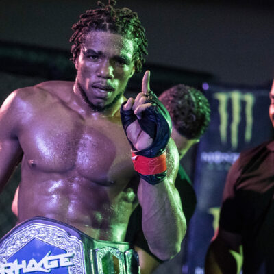 2019.08.03- T&T's Omar Smith celebrates his title belt victory over Ireland's Arron Daniels, tapping out in the first round during the RHAGE MMA (Mixed Martial Arts) title fight 155lbs at the Cascadia Hotel, St. Anns. Smith won the title belt by submission. Photo: Allan V. Crane/CA-images